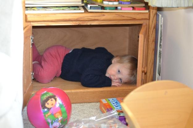 Favorite new hiding place: the puzzle shelf.
